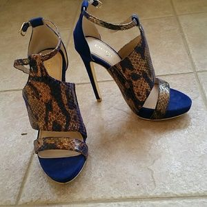 Bebe Blue and gold snake skin high heels